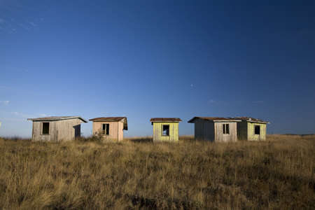 Abandoned old bungalows on a hill top