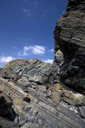 Rocky cliffs against blue sky