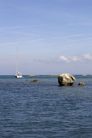 Black Sea coast and a beautiful yacht with white sails