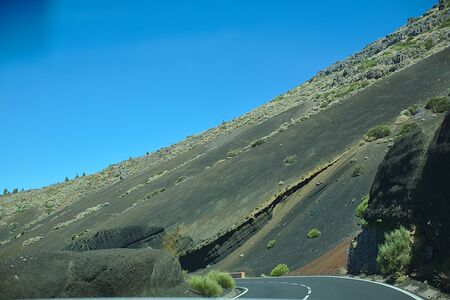 Road in a national park, in the mountains, sunny day, trip by car in nature, Canaries Island