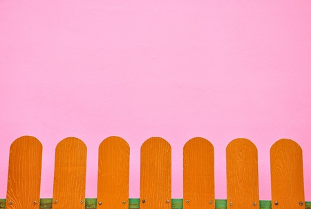 fence on a pink wall. photo