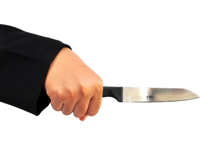 hand holding a knife  isolated on white photo