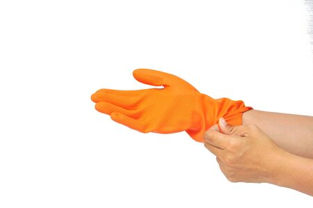 women hand in orange rubber glove isolated on white photo