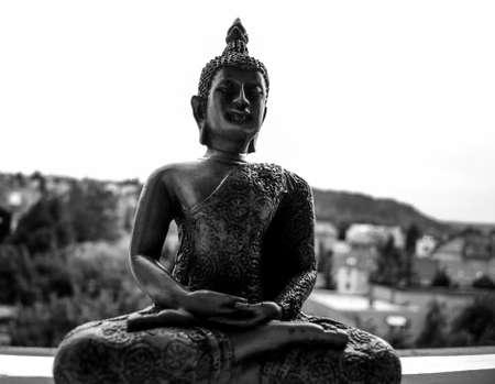 Buddha wooden statue in meditation
