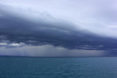dark sky storm cloudy and rain over the sea