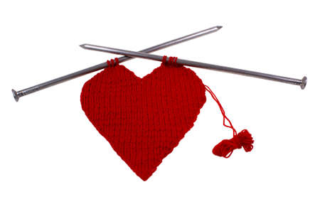 woollen heart made on wires isolated on white background