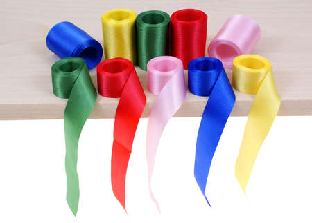 rolled up: colourful ribbon rolled up in rolls  isolated on white background