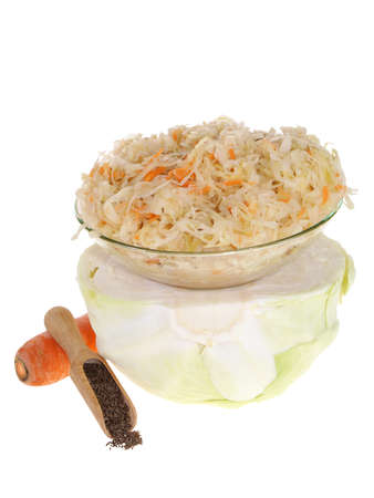 vitamines: sauerkraut and carrot isolated on white background