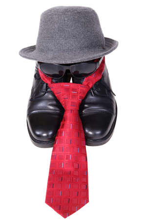 black shoes with tie and hat isoalted on white background photo