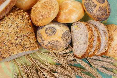 variable types of bread and rolls as background photo