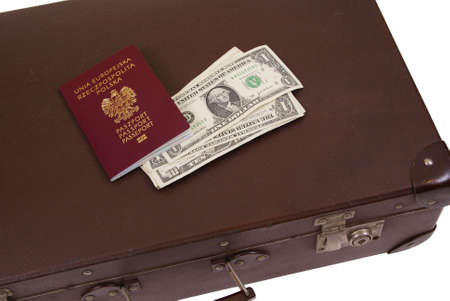 old suitcase with money and passport isolated on white background photo