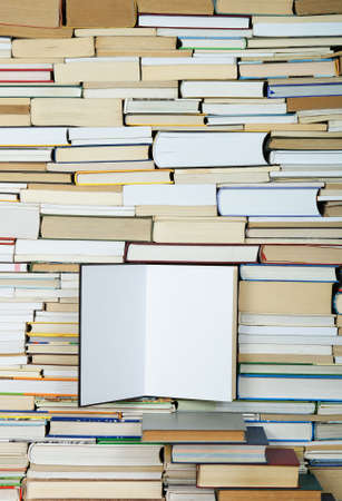 open book on background of arranged books photo