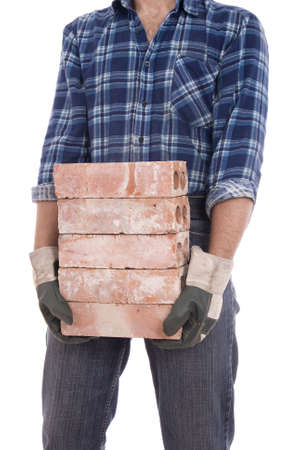 keeps: man in gloves keeps the  heap of bricks Stock Photo