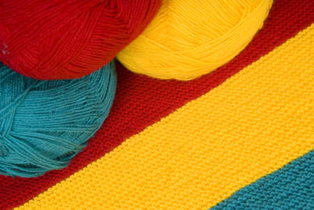hank: woolen needlework with three hank as background