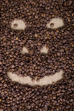 smiling face made from  grains of coffee photo