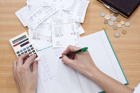 purse with money and shopping receipt on table Stock Photo