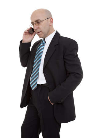 bespectacled man: man bespectacled in suit, talk through telephone