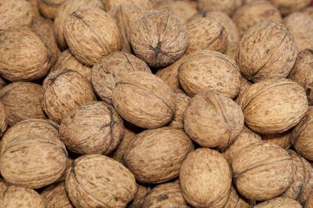 nutshell: big walnuts in nutshell as background Stock Photo