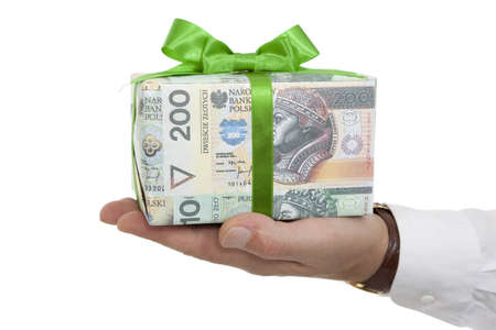 package with money and green ribbon on palm