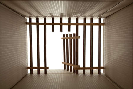 prison cardboard and wood lattice on white Stock Photo - 11746015