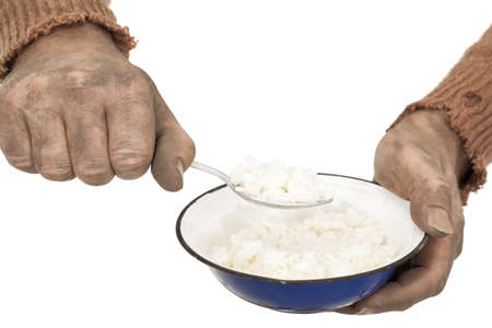 poor man in old sweater with  bowl rice Stock Photo