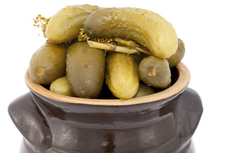 stoneware: pickled cucumber in stoneware on white background Stock Photo