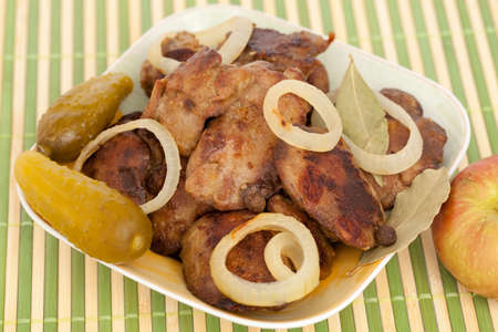 giblets: liver with chicken with onion on plate