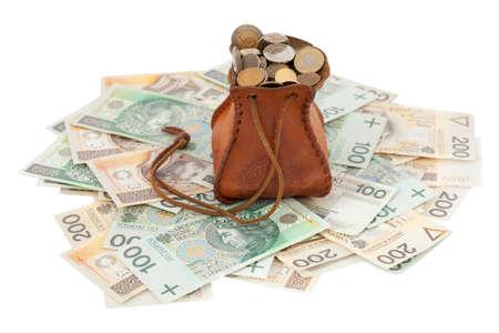 dissolved: piena di denaro borsa con le monete su banconote Archivio Fotografico