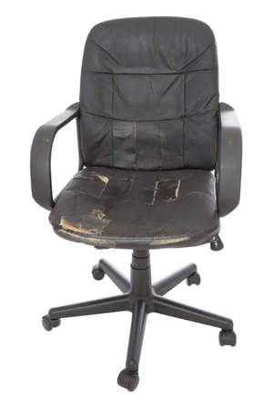 swivel chairs: black damage leather chair on white background Stock Photo