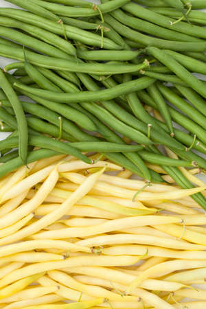 long bean:  two heaps green and yellow beans lies on table