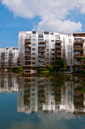 DEN BOSCH, NETHERLANDS - JULY 6, 2013: Modern Apartment Buildings in Den Bosch. Unique architecture residential buildings in a new nice neighborhood near to the central station. photo