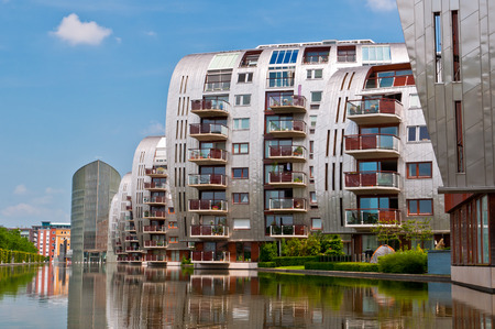 DEN BOSCH, NETHERLANDS - JULY 6, 2013: Modern Apartment Buildings in Den Bosch. Unique architecture residential buildings in a new nice neighborhood near to the central station.