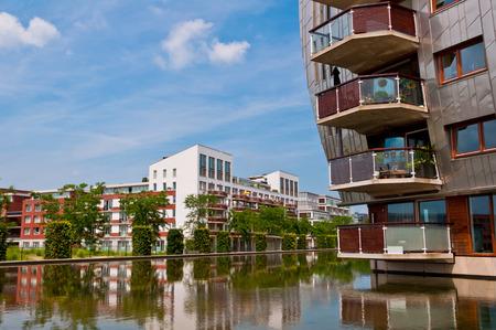 residential neighborhood: DEN BOSCH, NETHERLANDS - JULY 6, 2013: Modern Apartment Buildings in Den Bosch. Unique architecture residential buildings in a new nice neighborhood near to the central station. Editorial