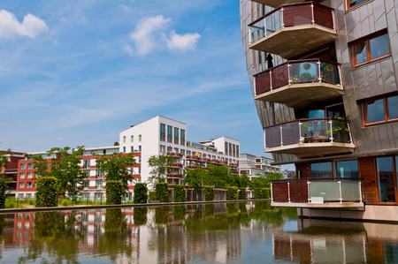 DEN BOSCH, NETHERLANDS - JULY 6, 2013: Modern Apartment Buildings in Den Bosch. Unique architecture residential buildings in a new nice neighborhood near to the central station. Редакционное