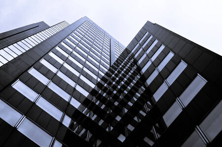 real estate property: Black Modern Architecture Skyscraper in City Downtown Stock Photo