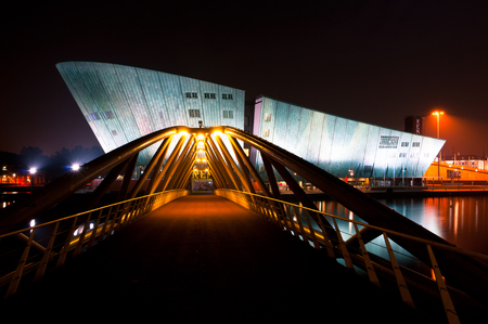 nemo: AMSTERDAM, THE NETHERLANDS - JULY 27: The Nemo Museum at night on July 27, 2013 in Amsterdam, Netherlands. Science Center NEMO is designed by Renzo Piano since 1997.