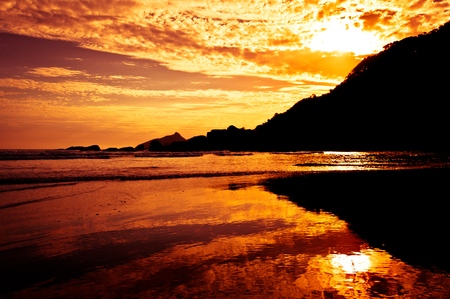 Save Download Preview Dramatic Tropical Sunset at Lopes Mendes Beach, Ilha Grande Island, Rio de Janeiro State, Brazil Stock Photo