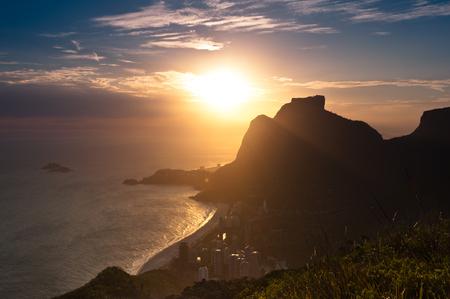 Sunset in Sao Conrado Beach in Rio de Janeiro, Surrounded by Mountains, the Sun is Going Down Behind the Pedra da Gavea Rock