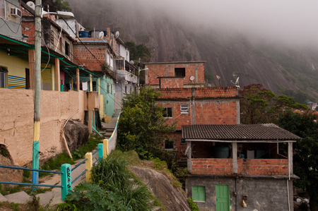 rack mount: Rio de Janeiro, Brazil - October 18, 2014: Fragile residential constructions of favela Vidigal in Rio de Janeiro. After installing Pacifying Police Units, favela became better and safer place to live in. Editorial