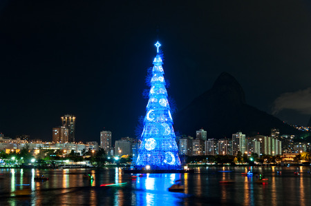 Tall Christmas Tree structure illuminated at night in the middle of the lake in Rio de Janeiro Stock Photo
