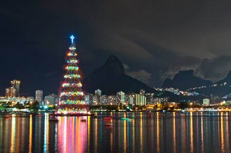 janeiro: Tall Christmas Tree structure illuminated at night in the middle of the lake in Rio de Janeiro Stock Photo