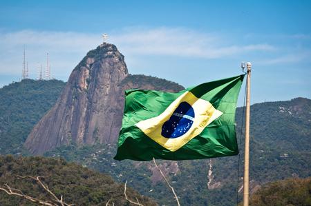 Waving Brazilian Flag with Corcovado Mountain in Rio de Janeiro Stock Photo