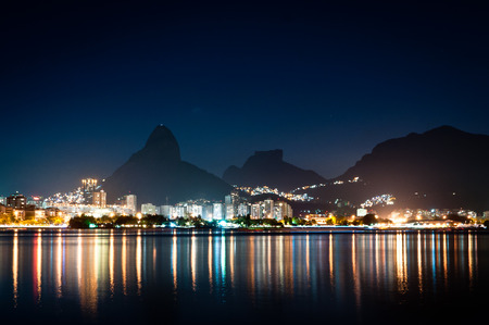 Nice Night View of Mountains and City Lights of Rio de Janeiro near Rodrigo de Freitas Lagoon Stock Photo