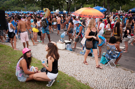 thousands: Rio de Janeiro, Brazil - February 16, 2015: Thousands of revelers in costumes take over the streets of the city center in Rios largest carnival street bands. Editorial