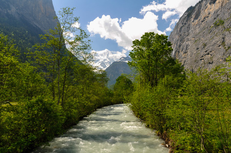 downstream: Rapid Stream in Lauterbrunnen Valley in Swiss Alps, Switzerland