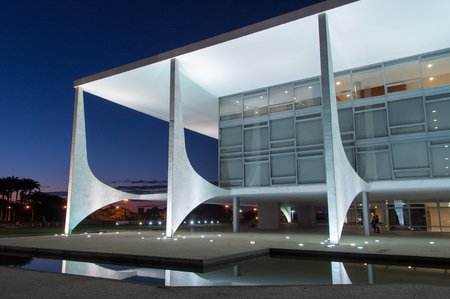 Brasilia, Brazil - June 3, 2015:  Planalto Palace at night, a residence of the president of Brazil. It was designed by Oscar Niemeyer and completed in 1960.