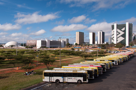 Brasilia, Brazil - June 6, 2015: Row of buses in the central bus station of Brasilia. Brasília was planned and developed by Lúcio Costa and Oscar Niemeyer in 1956.
