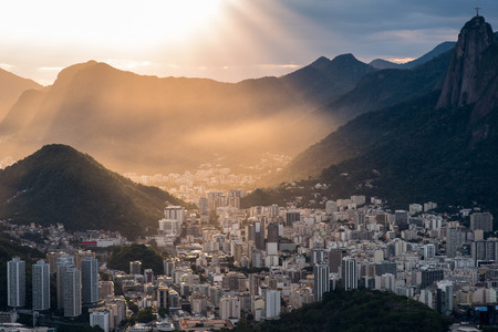 Sun is shining through the clouds on the Rio de Janeiro city, View from the Sugarloaf Mountain