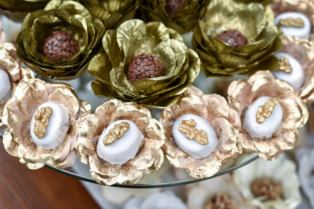 Decorative Candies and Pralines in Shiny Paper Wraps