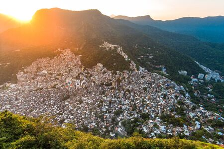 View of Rocinha, the Largest Favela in Rio de Janeiro City, by Sunset Behind Mountains